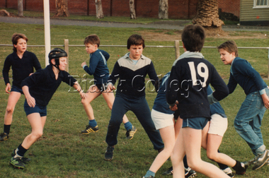 Photographs, Students playing football, 1986