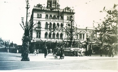 Photograph, National Mutual Building and Burke & Wills Monument decorated for the Ballarat Centenary 1938