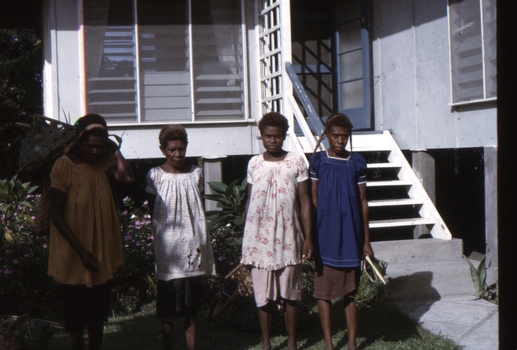 Papuan ladies at the front entrance of the Kinnane house in New Guinea.