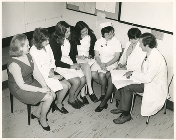 A Royal District Nursing Service (RDNS) Liaison Officer at a Hospital meeting