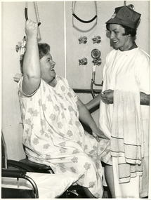 A Royal District Nursing Service (RDNS) Sister observing a patient using a transferring technique in her bathroom