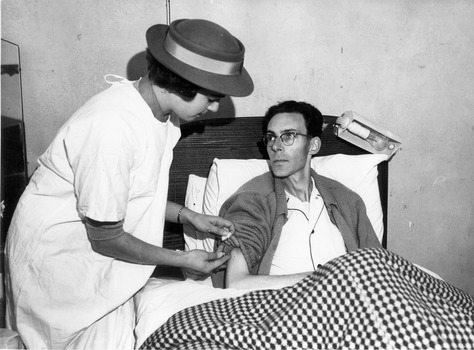 Melbourne District Nursing Society (MDNS) Sister administering an injection