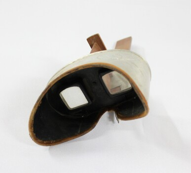Eyepiece of a stereoscope with cardboard 'view' of a streetscape