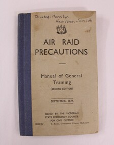 A blue and beige booklet with black text on front cover