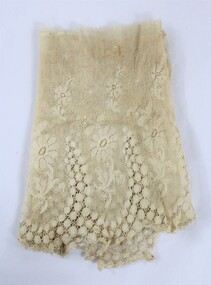 Cream coloured lace with floral motif