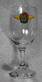 A wine glass including the Mylon logo to celebrate 100 years of operation