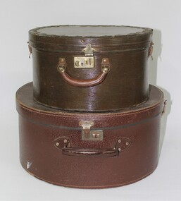 Two brown hat boxes, one small and one large