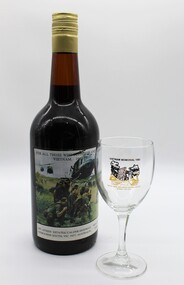 This bottle and glass is a presentation to Victorian Sub Branches with the iconic picture of soldiers awaiting a liftoff by helicopter.