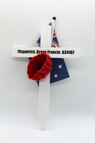 White Commemorative Cross, with red poppy and miniture Australian flag.