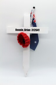 White Commemorative Cross, with red poppy and a miniture Australian flag.