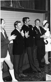 Black and white photograph, Opening of Power House Rowing Club with four men and one woman standing at the bar, 14 February 1970