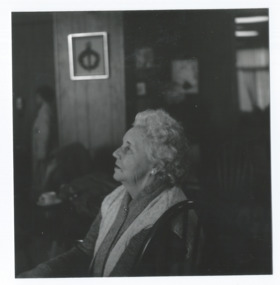 A widow in the widows club rooms of Legacy House.