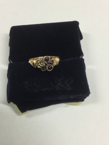 """Gold plated locket with """"Jean Mar 31st Dec 23rd"""" inscribed on the front."""