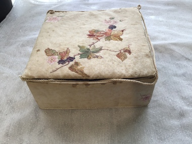From this view one can see the braid coming away from the lid and the stains and general poor condition of the box..