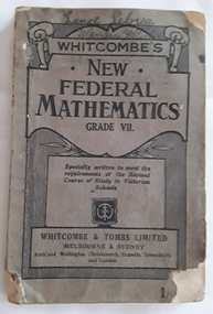 The grey covered textbook Whitcombe's New Federal Mathematics is very badly damaged with torn front and back covers. Lance Sebire Wandin Yallock is written at the top of the front cover
