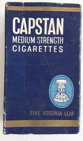 A small blue, gold and white cardboard Capstan Cigarette packet which contained 10 medium strength cigarettes.