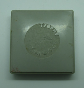 Grey medal case, Grey medal case containing gold medal from 1963 Victorian Paraplegic Games - Shot Put - Kevin Coombs, 1960