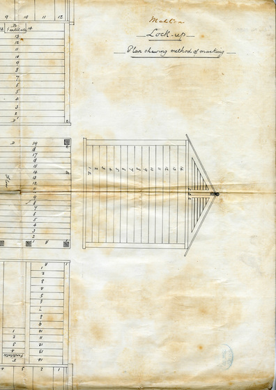 Plan with image of wooden lock-up building