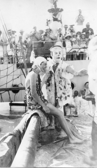 a man in fancy-dress  about to dunk a women in bathers