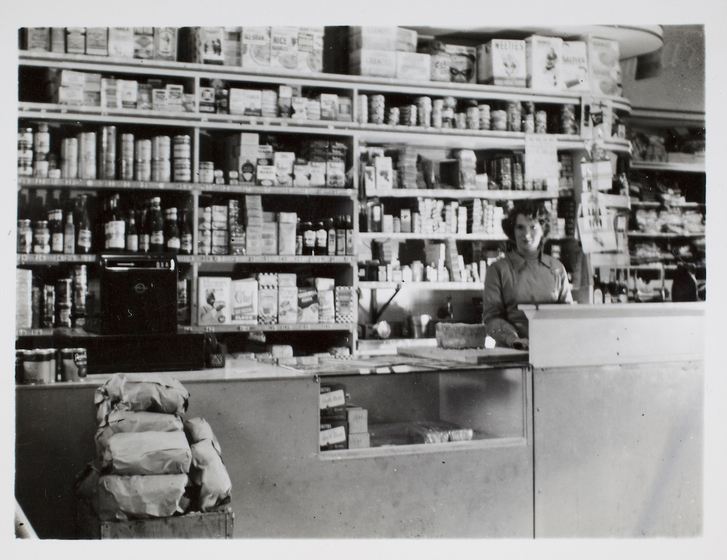 Woman standing in front of shelving