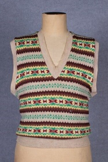 An intricate and multi-coloured hand knitted women's vest.